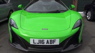 Supercars and classic cars leaving car show